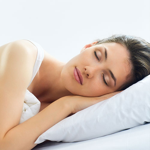 A women sleeping after undergoing sleep apnea therapy