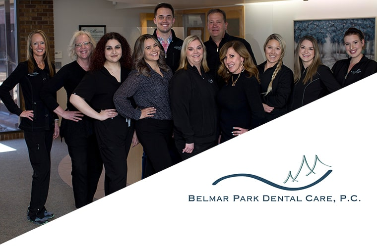 Your Lakewood Dentist and his team standing in their reception area