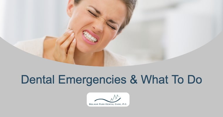A women holding her mouth because of a dental emergency